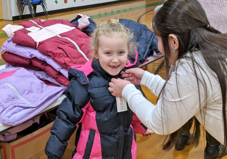 Coat Giveaway warms hearts & keeps children warm all winter